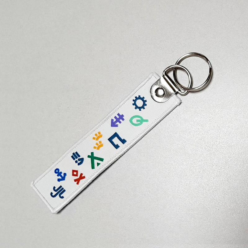 Porte-clés en tissu avec symboles Scouts et Guides de France